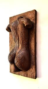 y female torso copper wall