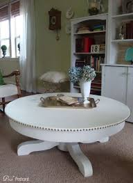 cut down the pedestal of a dining table to make a coffee table this would make a great game table just throw some pillows around it on the floor