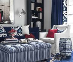blue and white furniture. a unifying color scheme of blue and white pulls this living room together centered on furniture m