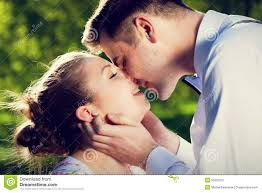 Young Romantic Couple Kissing With Love In Summer Park Stock Image