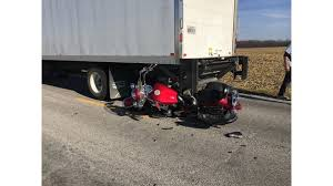 Delivery Truck Driver Backs Up Collides With Motorcycle