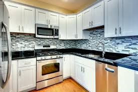 kitchen subway tile backsplash white cabinets with gray kitchens ideas and dark countertops patterned blue modern