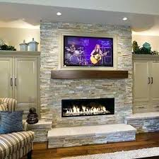putting a above your mantel linear corner fireplace tv ideas best on mantle  stone