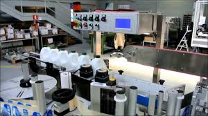 <b>Automatic Labelling Machine</b> Applying <b>Labels</b> to Dairy Industry ...