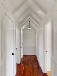 tongue and groove paneling hall traditional with chair rail sloped ceilings vaulted ceilings wainscoting