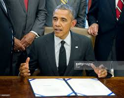 president barack obama signs hr 685 in the oval office at the white house on may barak obama oval office golds