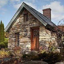 Beautifully detailed with a brick chimney, tall multi-pane windows and an  inviting wooden door. Perhaps cottage style guest house?
