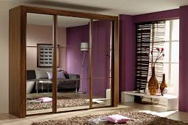 image mirrored sliding. mirrored sliding door design bedroom wardrobe with purple wall and unique curtain image r