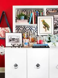 white cabinet and shelf with red wall