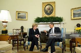 obama oval office. us president barack obama speaks with german chancellor angela merkel during meetings in the oval office