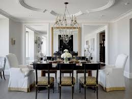... Artistic ceiling design and lovely chandelier give this dining room in  neutral tones a classic look