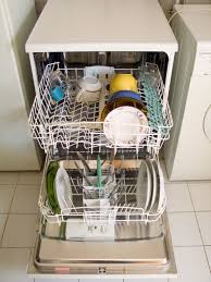 dishwasher in restaurant. dishwasher, open and loaded with dishes dishwasher in restaurant