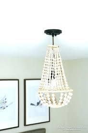 chandeliers elena wood bead chandelier chandeliers pottery barn gold elena wood bead chandelier
