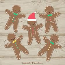 gingerbread man cookies on a wooden background free vector