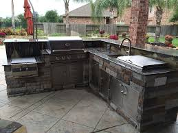 kitchen l shaped outdoor grill grey brick kitchen glass front upper cabinet green rustic wood