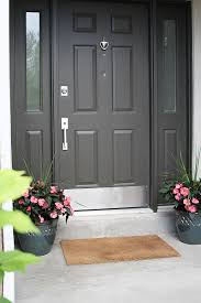 entry door kick plates. i threw in some pots and flowers also from home depot bam, my door is now part of 2014. the curb appeal so much better! entry kick plates e