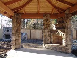outdoor fireplace with bbq grill and oven traditional