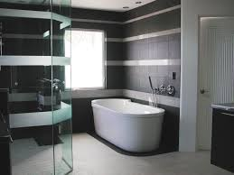 gorgeous black accents tiles wall ideas for large bathroom filled with awesome glass shower enclosure and pleasant white freestanding bathtub