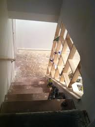 this idea creates a code safe stair wall and an open area to