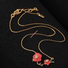 juicy couture gold tone diamond flower