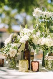 Ivory Flowers in Glass-Bottle Centerpiece