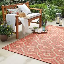 tribal inspired ogees embellish the contemporary canvas of mohawk home s morro indoor outdoor area rug cast in a c and natural sisal color palette