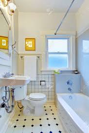White Old Simple Bathroom With Tub And Sink Stock Photo Picture - Simple bathroom