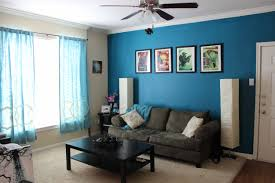 bedroom colors brown and blue. Inspiration, Interior Living Room Color Blue Wall Paint Electric Fan With Light Gray Sofa Cushions Bedroom Colors Brown And S
