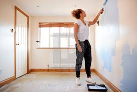 woman decorating room in new home