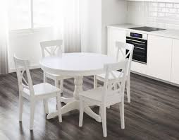 eye catching round white dining table and eames chair set tables ikea design dubai target room chairs tablecloths gl hire glasgow side legs wooden