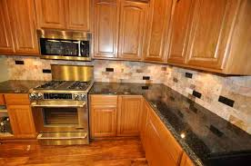 Amazing Image For A Kitchen Remodel With Scabos Tile Backsplash And Uba Tuba Granite  Countertop Design Pictures