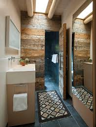 View in gallery Hard to miss the magic of reclaimed wood in this  space-conscious bathroom! [