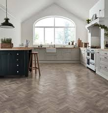 create a modern parquet look with the ashy grey tones of storm oak luxury vinyl flooring featuring a hand sed emboss that gives an authentic look