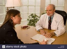 Pharmaceutical Representative Doctor Meets With Drug Rep Pharmaceutical Representative Stock