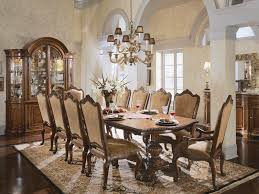 luxury dining room design with brown fabric upholstered dining room chairs double pedestal dining table