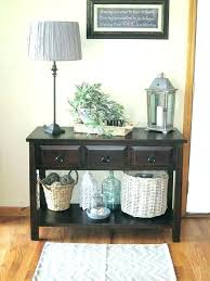 round entry hall table small entry hall tables entry hall table baskets on lower shelf of