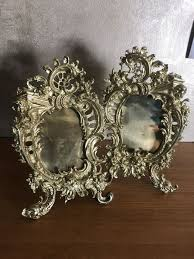 two bronze brass picture frames with angel head