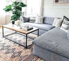 grey couch with tribal oriental rug