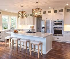 white cottage kitchen with 4 light chandelier marble breakfast island bar stools