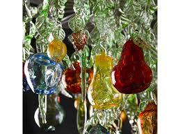 glass chandelier with green leaves blown fruit and berries