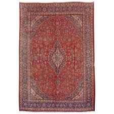 large kashan persian rug in red blue and beige for