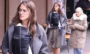 Keira Knightley goes make-up free and carries newborn baby Delilah
