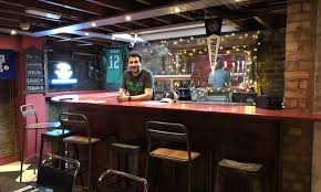 owner jp teti stands behind the basement bar at passyunk avenue a philly themed