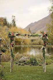 moody wooden arch with dark fls and greenery