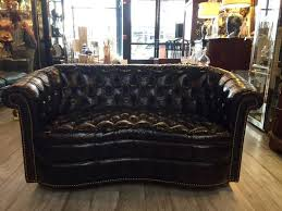 very rare find in rich dark brown leather this wonderful curved tufted chesterfield loveseat oozes