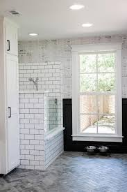 black and white mudroom with dog shower