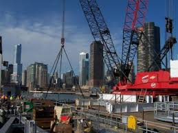 Crane From Central Contractors Service Rides A Barge