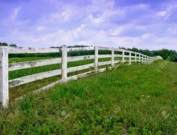 White Wood Fence In A Field In The Country Stock Photo Picture And