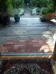 recycled brick steps with wood edge on a wood deck