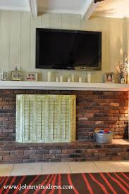 diy upcycled shutter fireplace screen